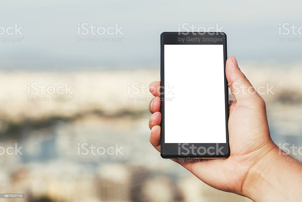 Hand with smart phone stock photo