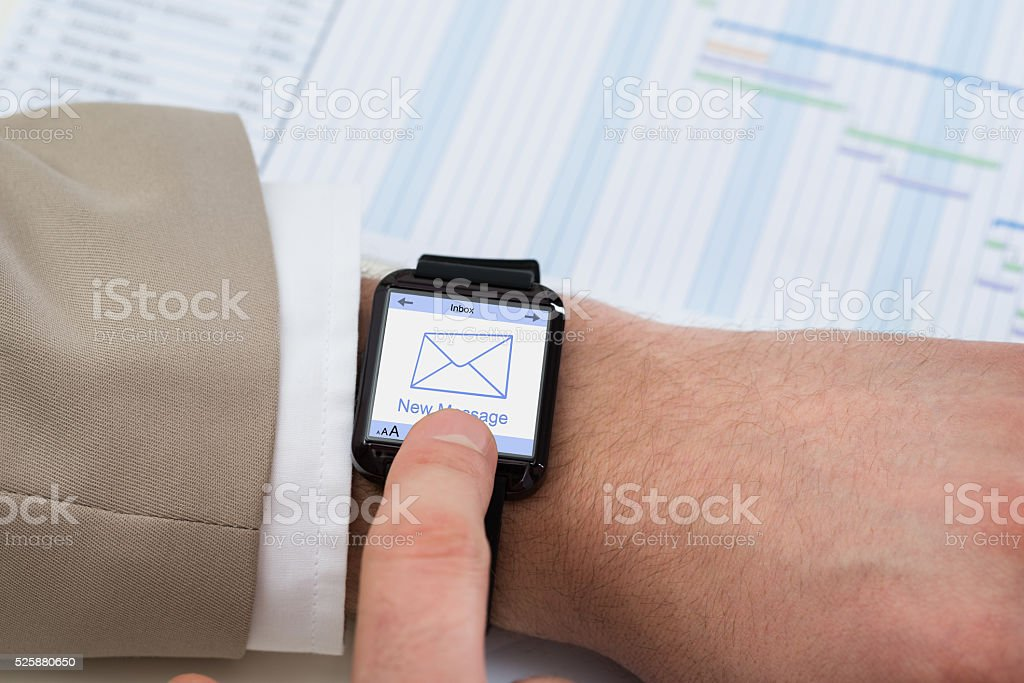 Hand With Smartwatch Showing Unread Message stock photo