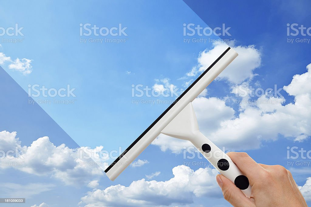 Hand With Squeegee Cleaning Dirty Window stock photo