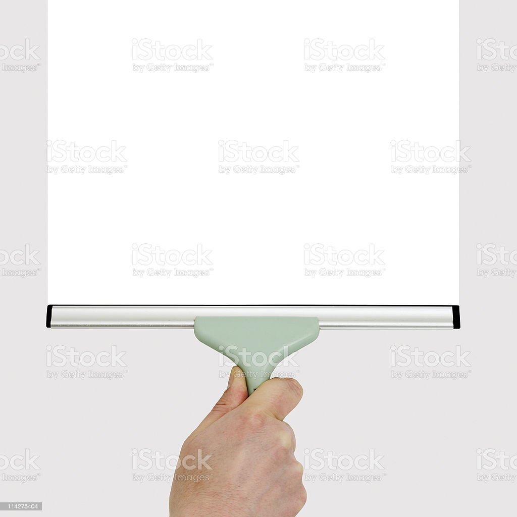 hand with squeegee cleaning stock photo