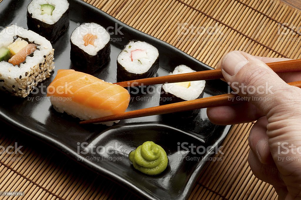 hand with sushi royalty-free stock photo