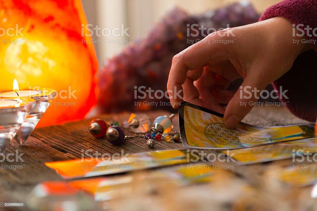 Hand with tarot card stock photo