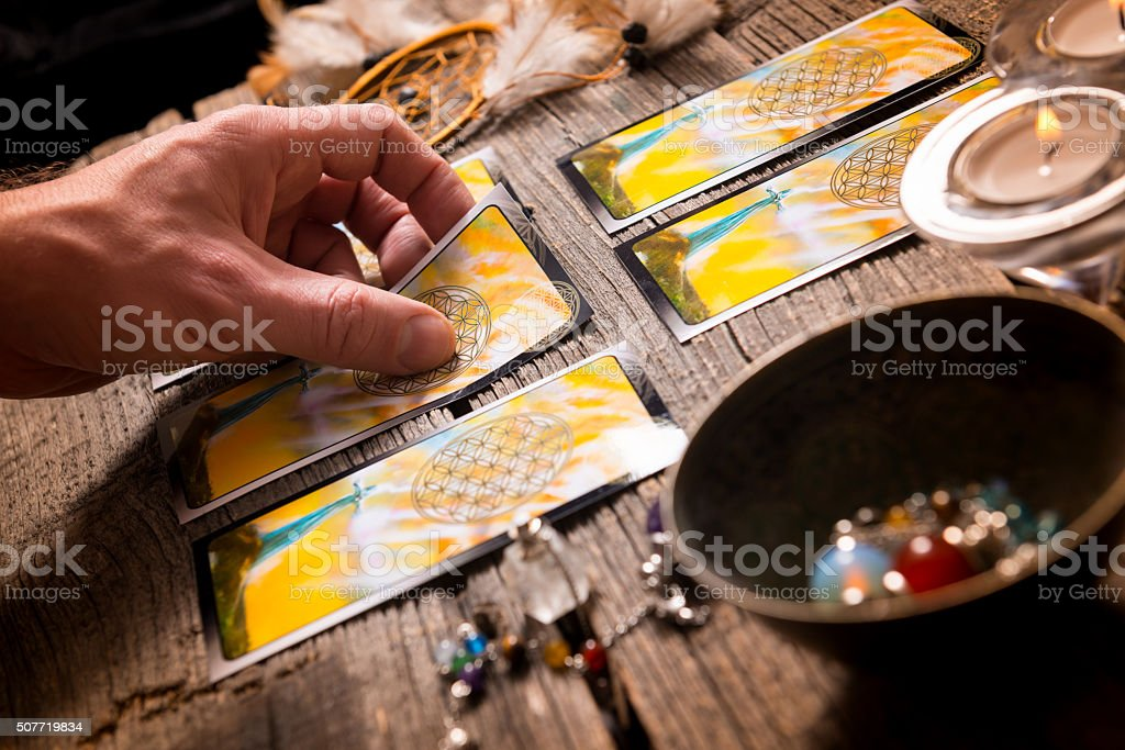 Hand with tarot cards stock photo