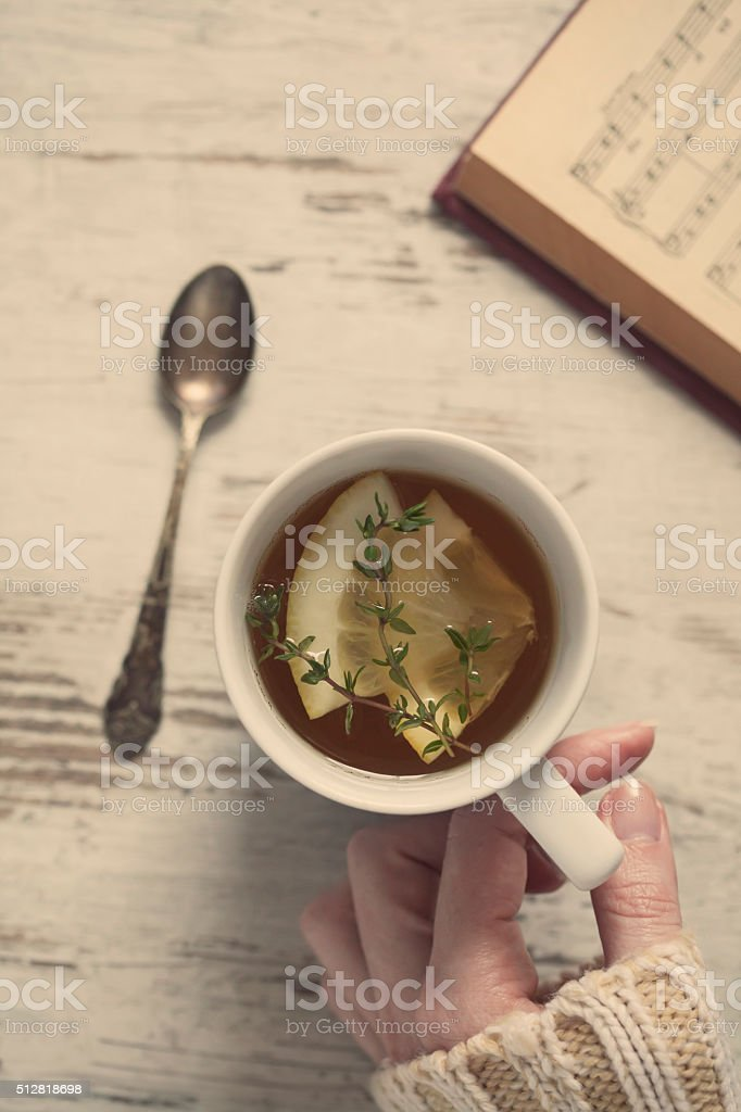Hand with tea cup stock photo