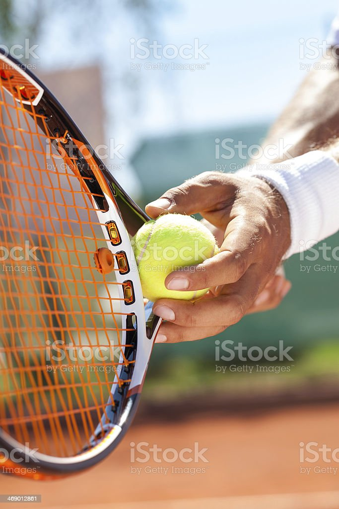 hand with tennis ball and racket stock photo