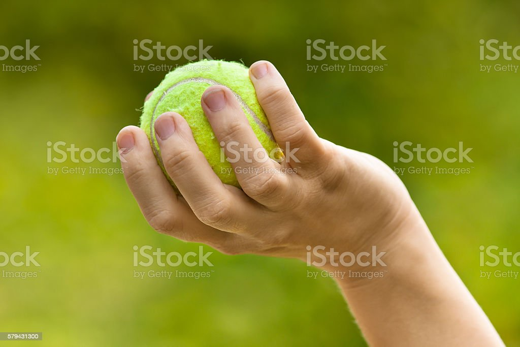 hand with tennis ball stock photo