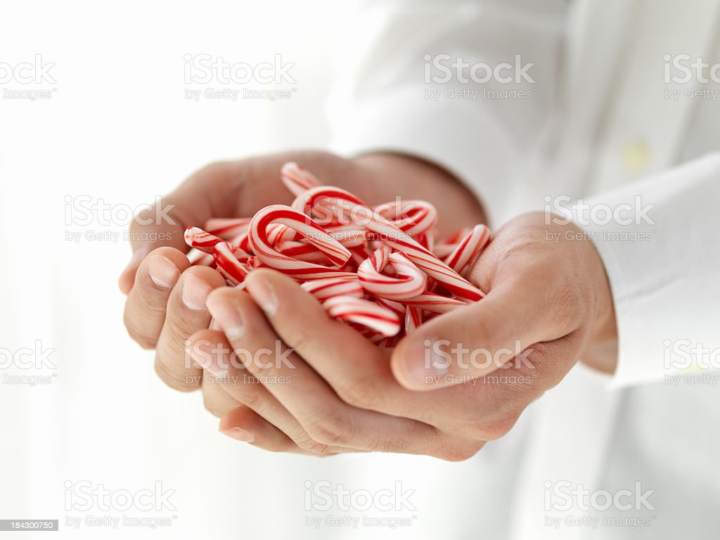 Hand with the candy royalty-free stock photo