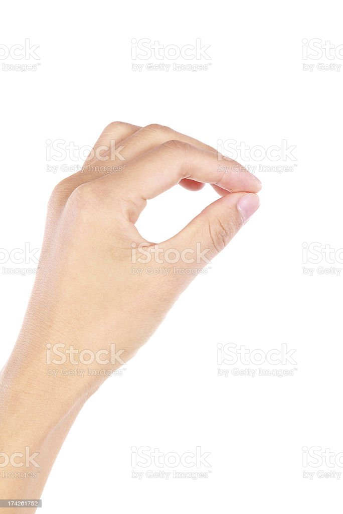 Hand with thumb and index finger touching royalty-free stock photo