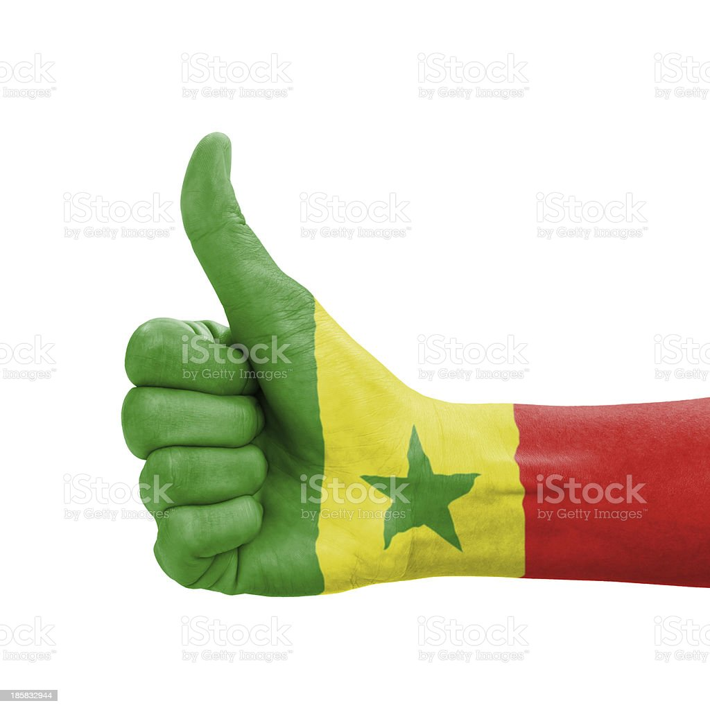 Hand with thumb up, Senegal flag painted stock photo