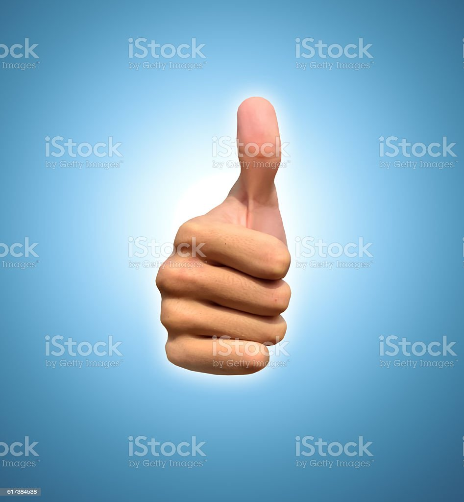 Hand with thumb up, view from the front stock photo
