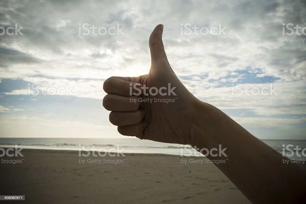 Hand with thump up in like symbol stock photo