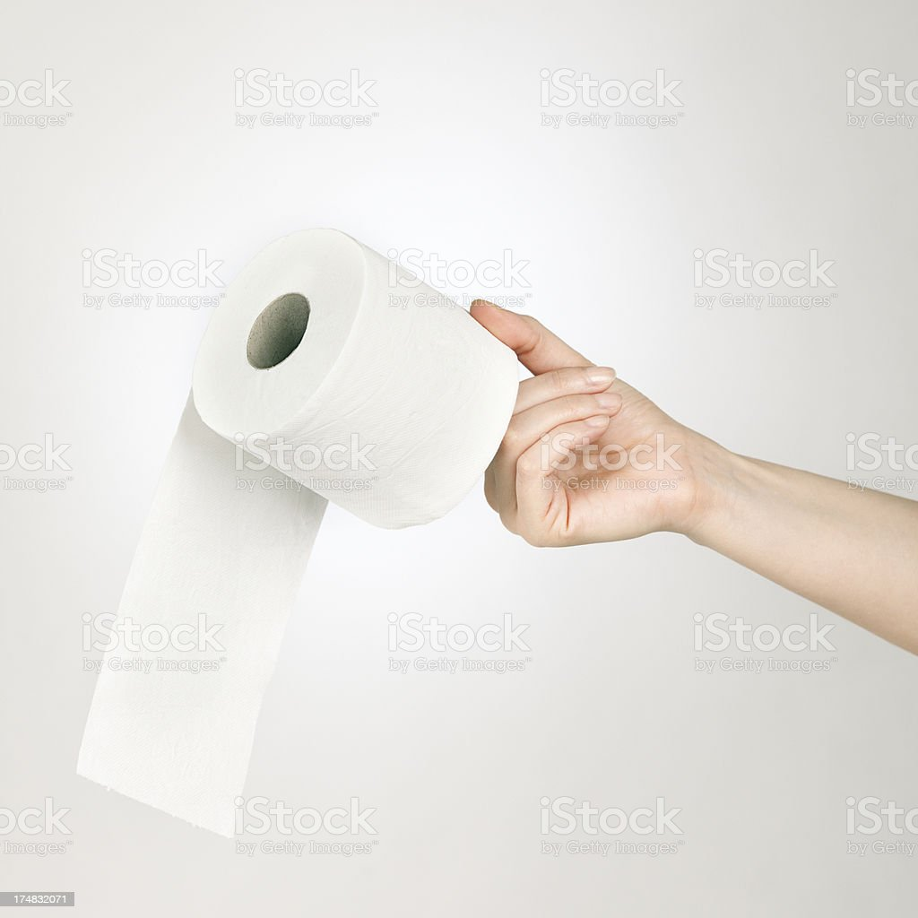 Hand with toilet paper royalty-free stock photo
