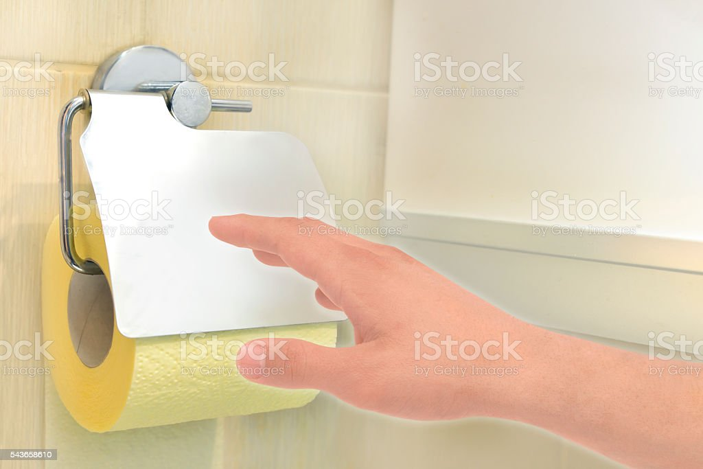 hand with toilet paper stock photo