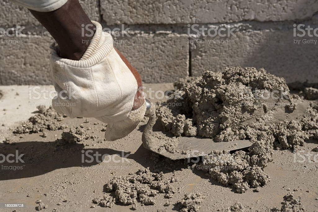 Hand with trowel royalty-free stock photo
