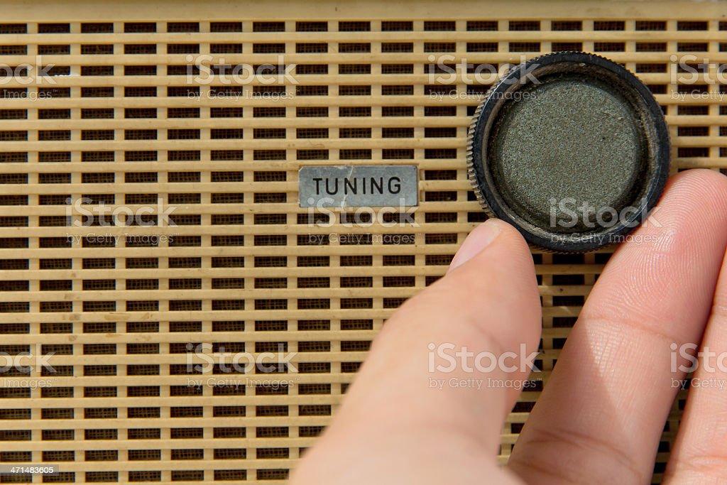 hand with tuner radio knob royalty-free stock photo