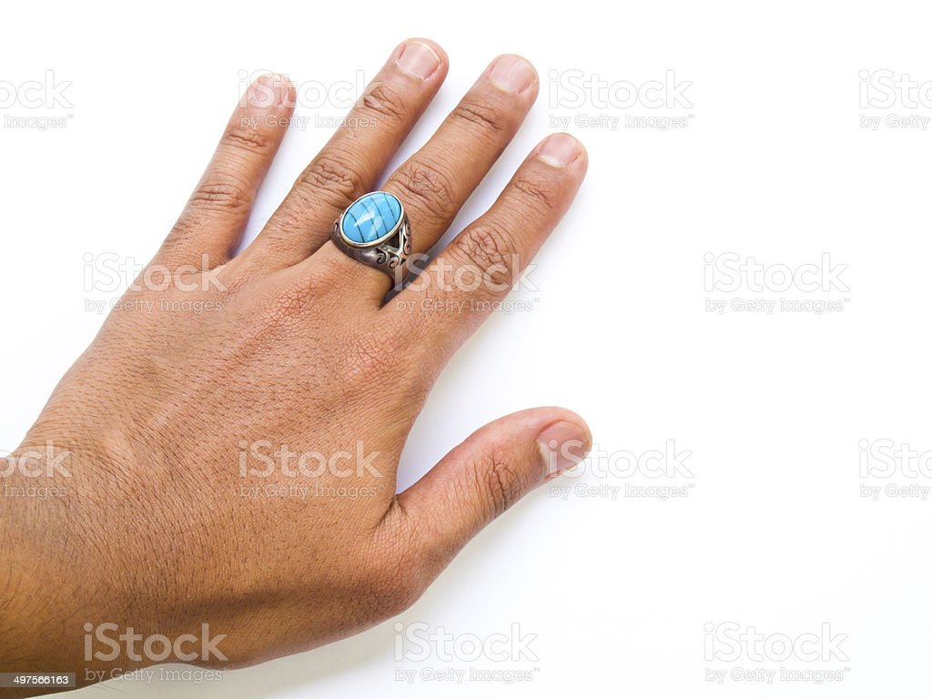 hand with turquoise  ring on his finger stock photo