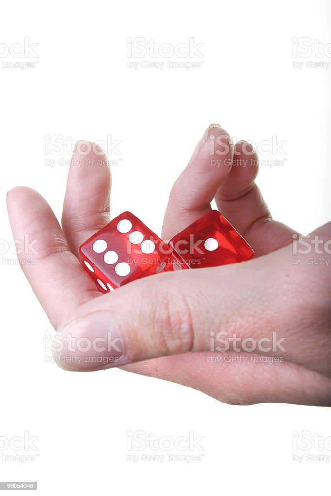 Hand with two dice royalty-free stock photo