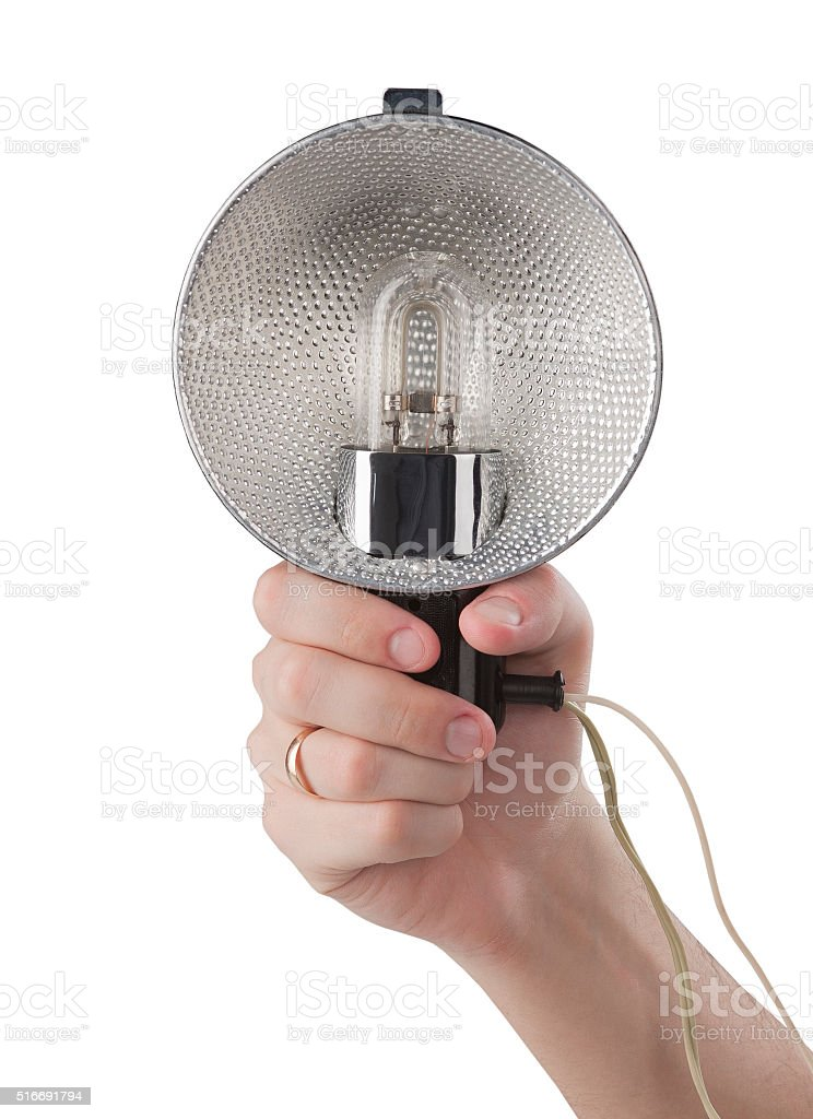 hand with vintage photo flash isolated on white background stock photo