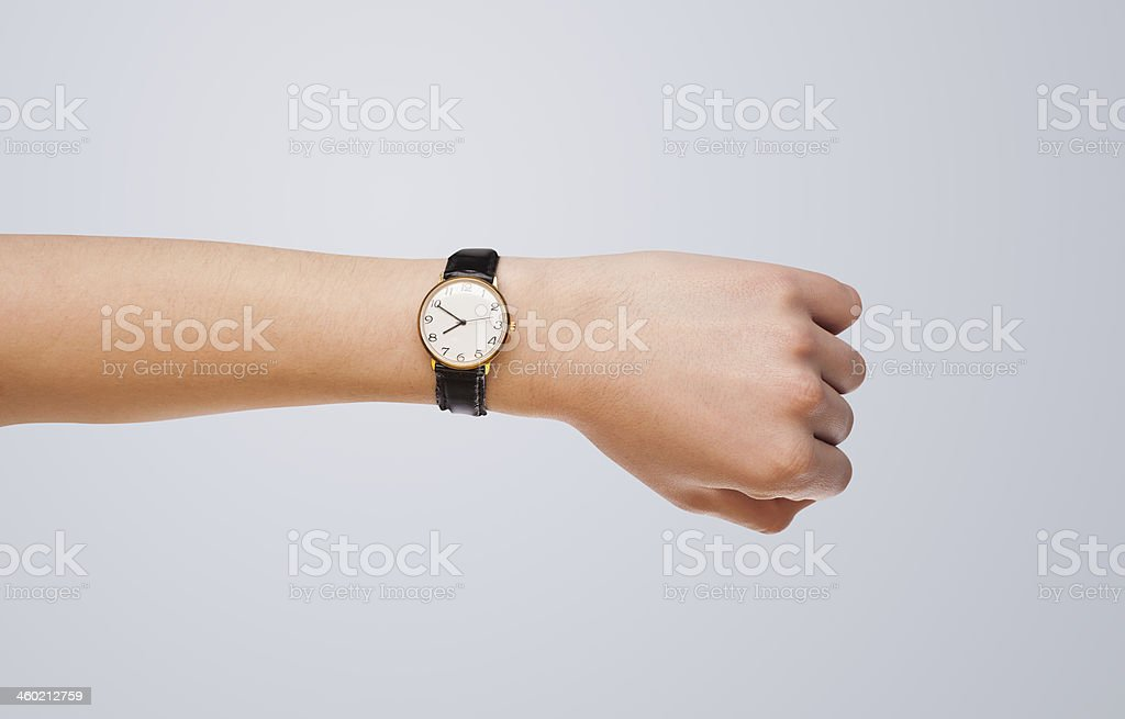Hand with watch showing precise time stock photo