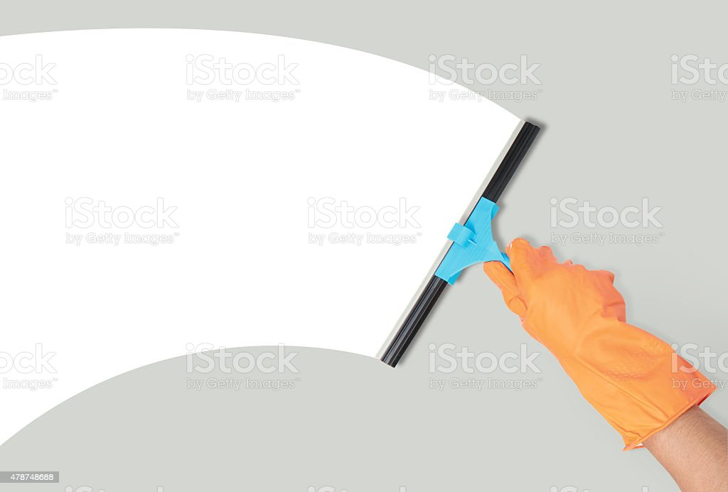 hand with window cleaning tool stock photo