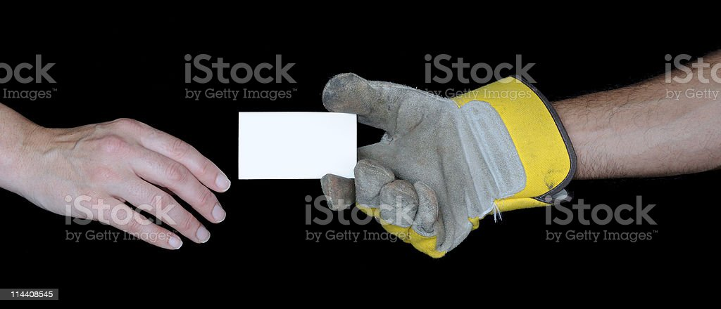 Hand with Work Glove Giving Business Card to a Customer royalty-free stock photo
