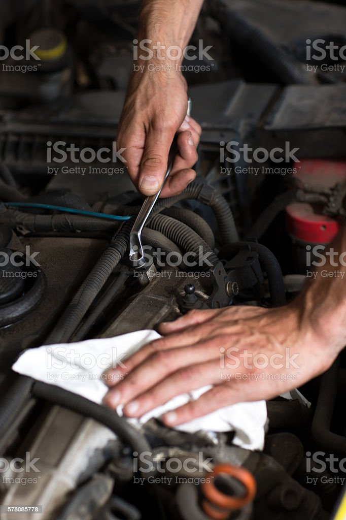 Hand with wrench close up stock photo