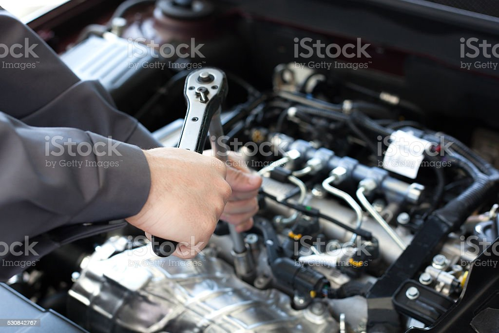 Hand with wrench stock photo