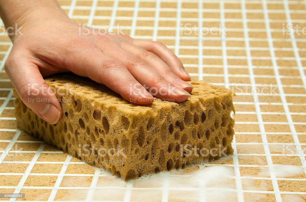 Hand with yellow sponge royalty-free stock photo