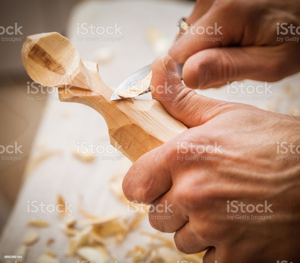 hand woodcarver stock photo