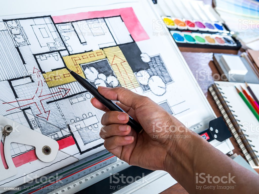 Hand working with architecture hand-drawn sketch on creative worspace stock photo