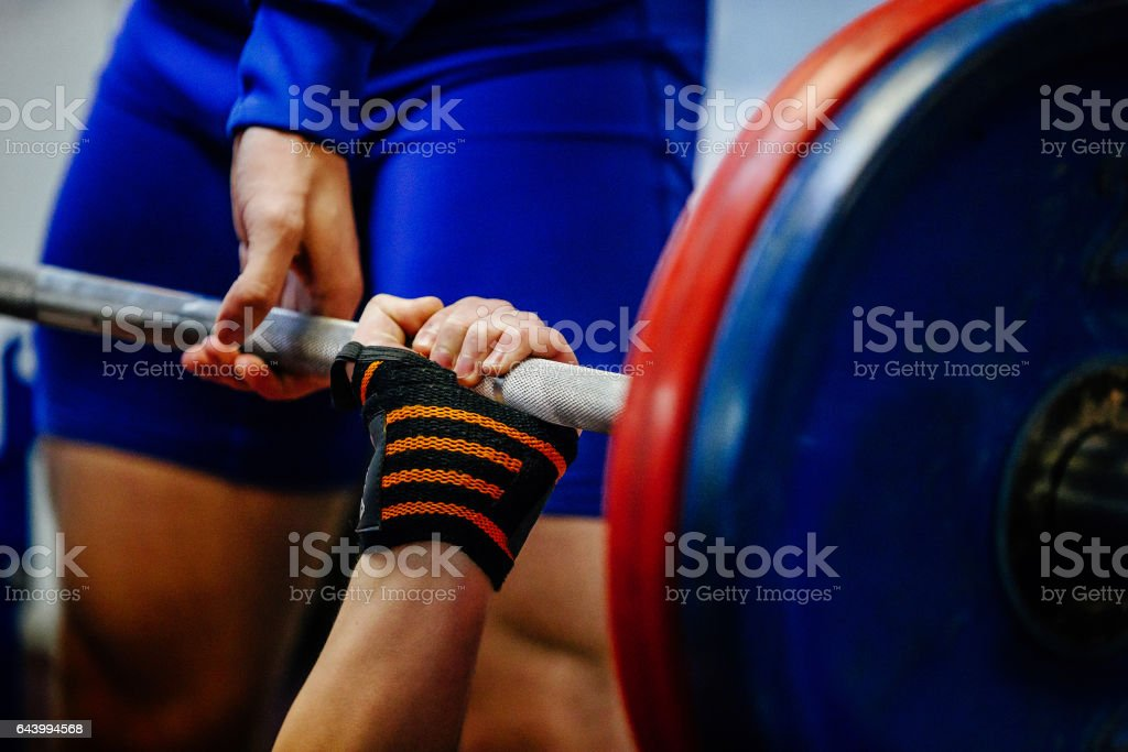 hand wristbands young men powerlifter bench press stock photo