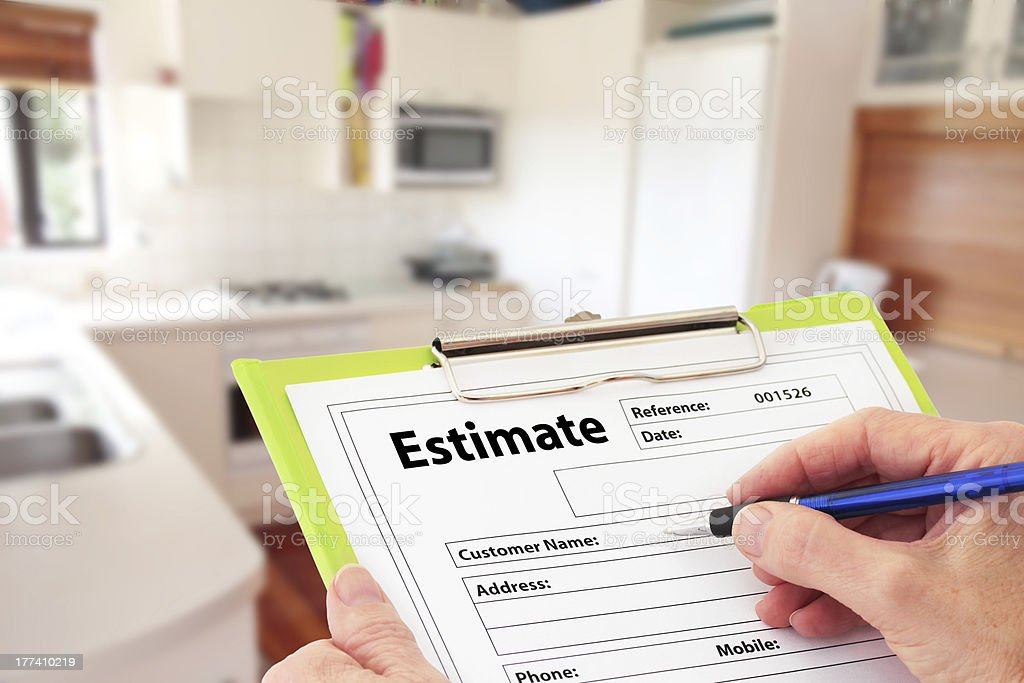 Hand Writing an Estimate for Kitchen Renovation royalty-free stock photo