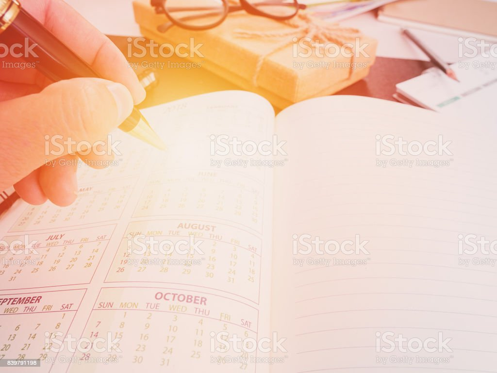 Hand writing blank planning notebook on desk use us organizer schedule life or business planner concept stock photo