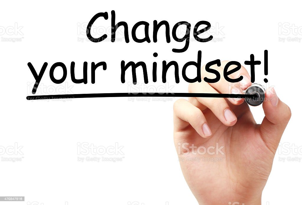 Hand writing Change your mindset in black marker stock photo