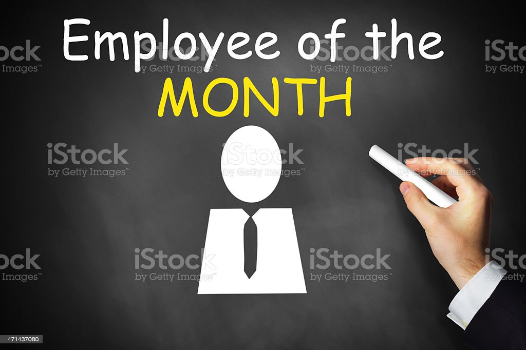 hand writing employee of the month on black chalkboard stock photo