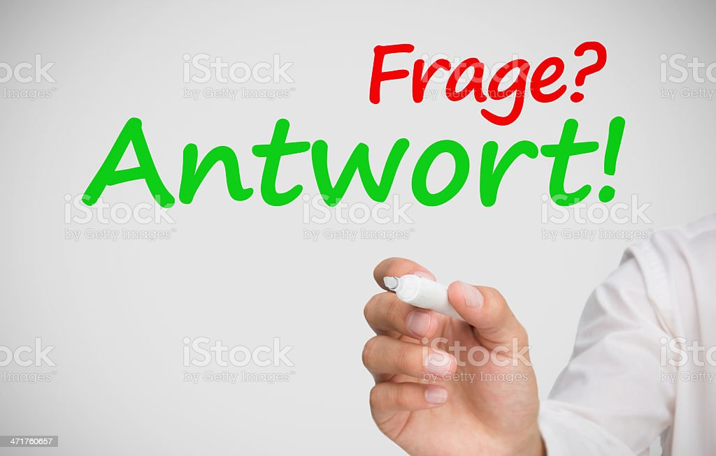Hand writing frage and antwort with a marker stock photo