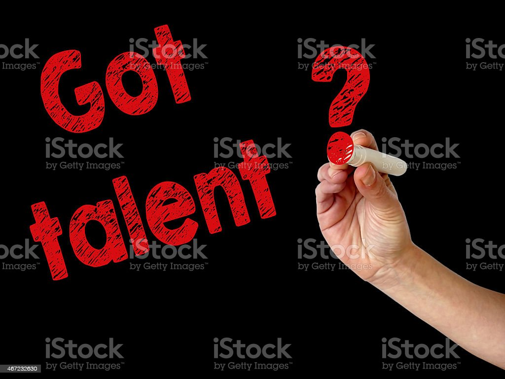 Hand writing got talent with red marker on blackboard stock photo