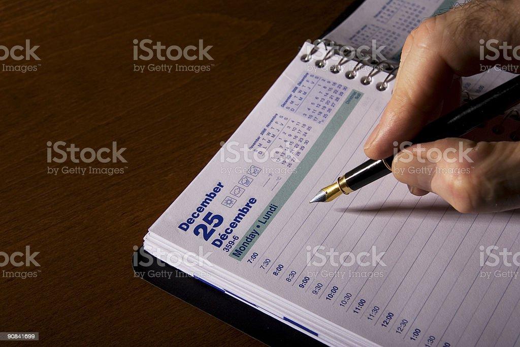 Hand writing in Agenda 2 royalty-free stock photo