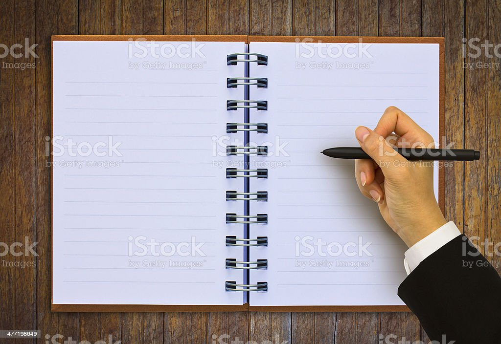 Hand writing in open paper on table royalty-free stock photo