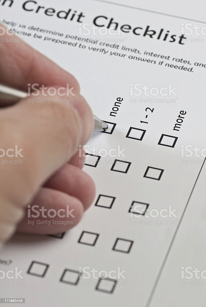 Hand Writing on a Checklist royalty-free stock photo
