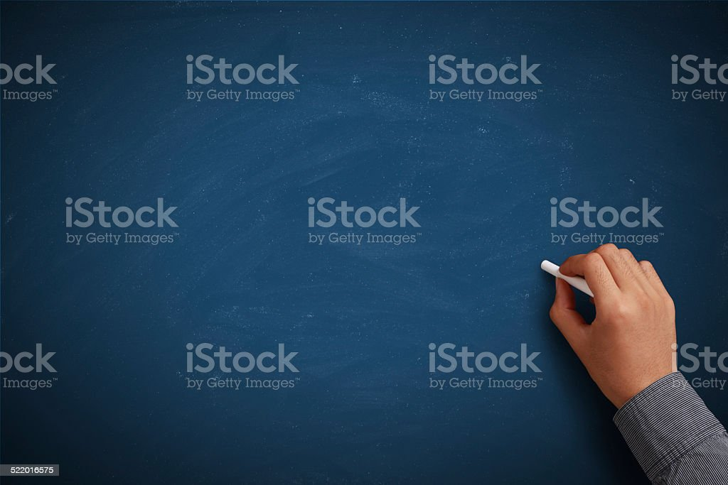 Hand writing on blank blue chalkboard stock photo