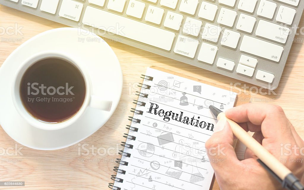 Hand writing on book message Regulation. stock photo