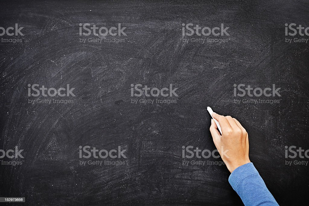 Hand writing on chalkboard / blackboard royalty-free stock photo