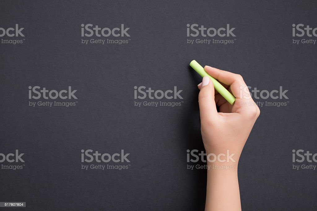 Hand writing on chalkboard with green chalk stock photo