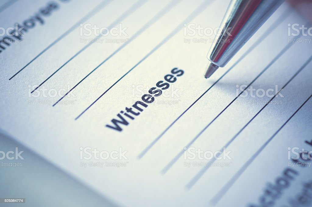 Hand writing on incedent witnesses paper. stock photo