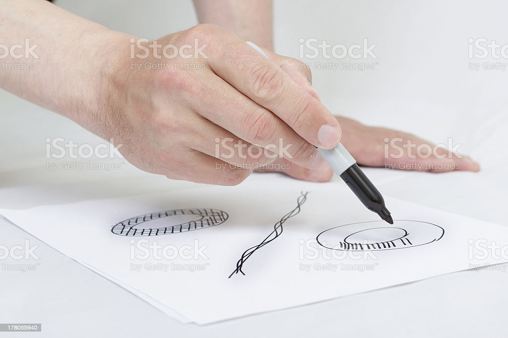 Hand writing percent symbol on white paper. royalty-free stock photo