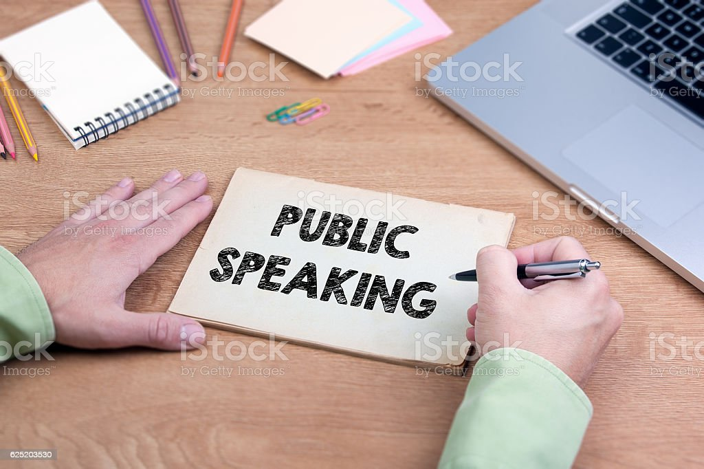 Hand writing Public Speaking. Office desk stock photo