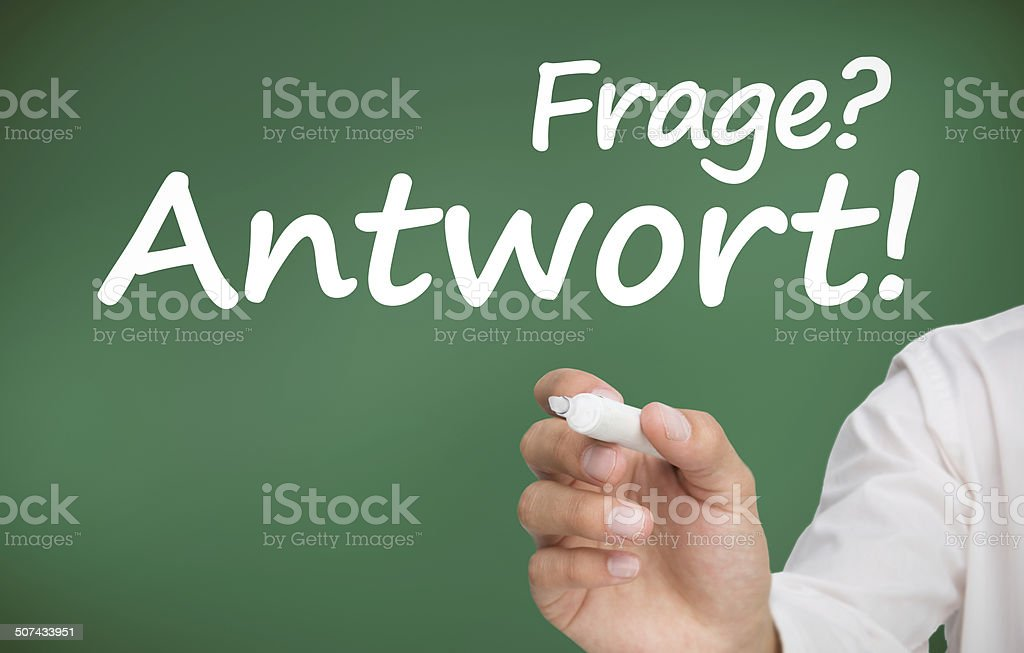 Hand writing questions and answers in german with a marker stock photo
