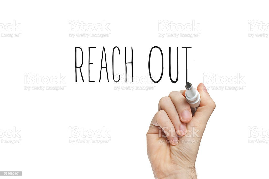 Hand writing reach out stock photo