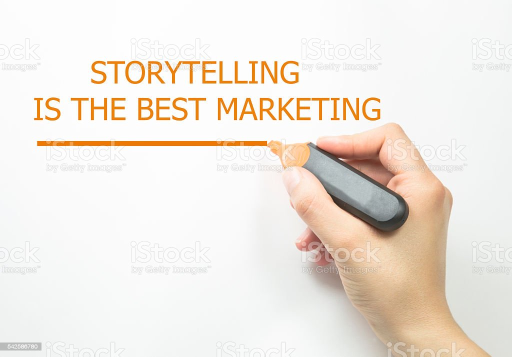 Hand writing Storytelling is the best Marketing stock photo